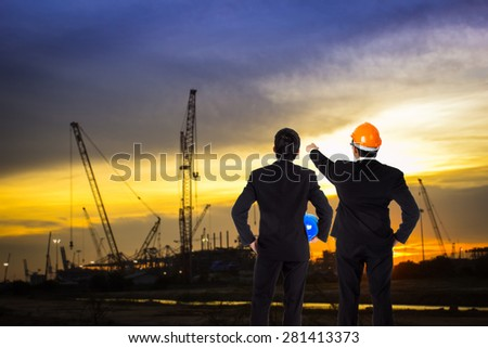 Two Engineer discussing about construction site progress in twilight time. #281413373