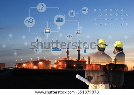 two engineer on site , Industry 4.0 concept image.Oil refinery at twilight with cyber and physical system icons diagram on industrial factory and infrastructure background. #551879878