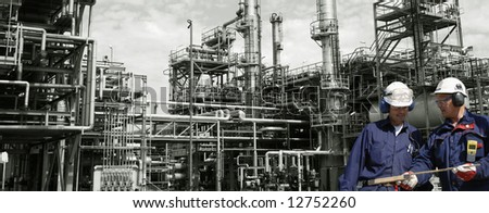 two engineers in front of large oil refinery, panoramic idea