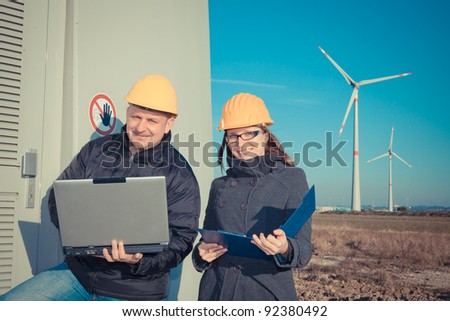Two Engineers in Wind Turbine Power Generator Station