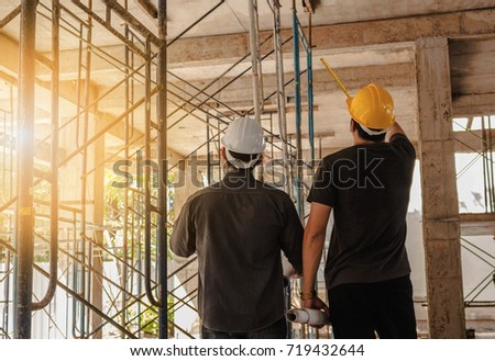 Two engineers working in a construction site