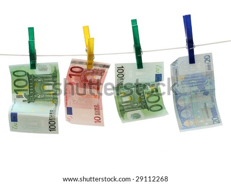 Two 100 Euro bills and one 20 and 10 Euro note on white rope. Concept of Money Laundry #29112268