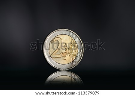 Two euro coin. Dark background with backlight