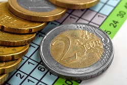two euro coins and business report, close up