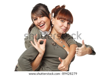 Two excited girls showing OK signs, isolated on white background