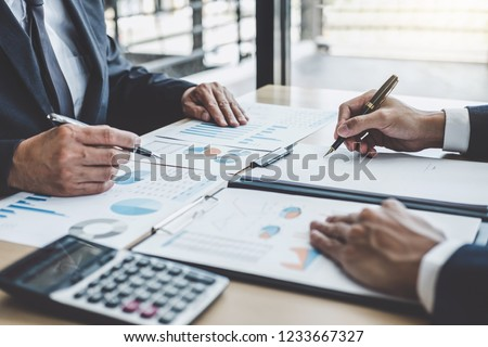 Two executive discussing company growth project success financial statistics, Partner meeting professional investor working start up project for both company with document, laptop and digital tablet. #1233667327