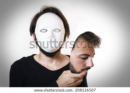 Two faced male, real face is actually mask.