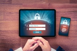 Two-factor authentication (2FA) and fingerprint touch identification security concept. User with digital tablet and smart phone and two-factor authentication security process, flatlay design.
