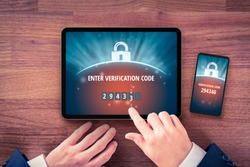 Two-factor authentication (2FA) and verification security concept. User with digital tablet and smart phone and two-factor authentication security process. Verify code on smart phone, flatlay design.