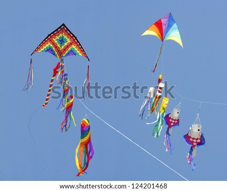 Two Fancy Kites Flying in a Bright Blue Sky