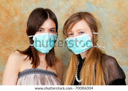 Two fashion girls with protective medical masks