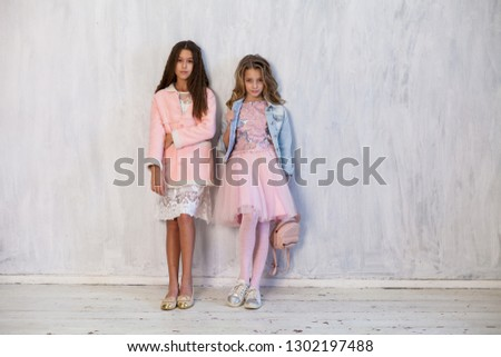 two fashionable girls girlfriend in school uniforms #1302197488