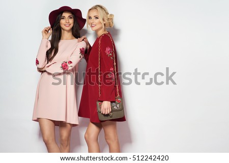 Two fashionable women in nice dresses. Fashion autumn photo #512242420