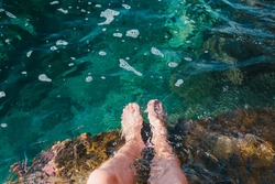 Two feet dipping  in water.Foot spa