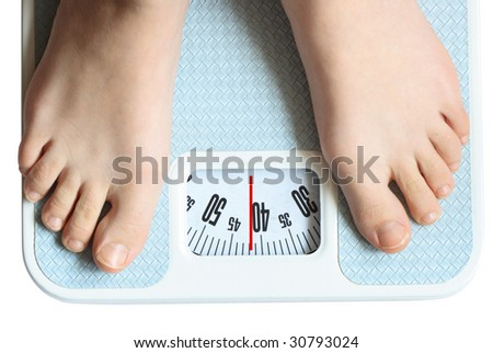 Two feet standing on the bathroom scale isolated with clipping path