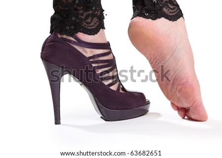 Two feets with high-heel and without