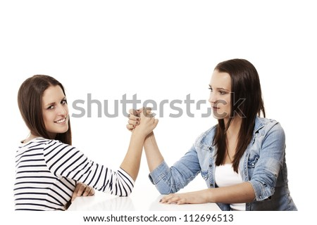 two female arm wrestling teenager on white background