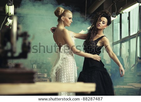 Two female beauties in a dancing pose