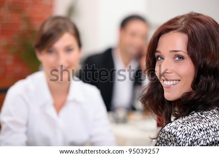 Two female friends at a restaurant.