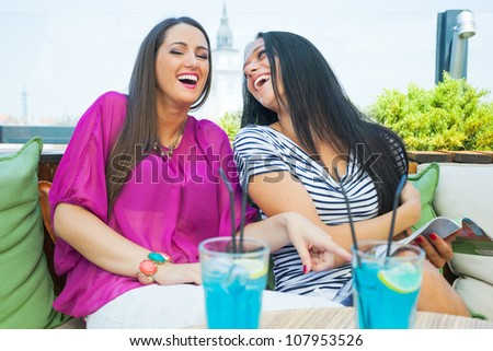 Two female friends in cafe