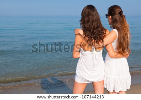 Two Female Friends Looking Horizon at Seaside