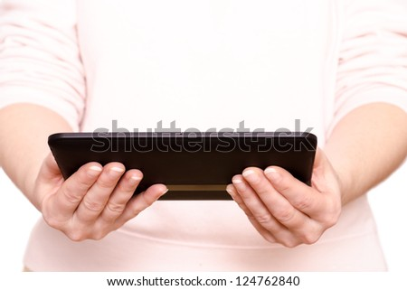 Two female hands are holding a tablet computer
