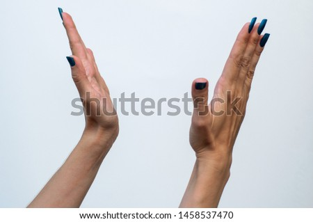 two female hands on a gray background gesture clapping applause cheering cheers cheer plaudit #1458537470