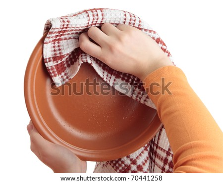 Two female hands wipe ceramic dish with checkered towel