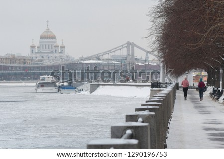 Two female joggers in the Gorky Park. And view at Moscow River, Krymsky Bridge and Cathedral of Christ the Saviour. Moscow, Russia. #1290196753
