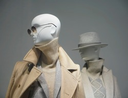 Two female mannequins wear luxury style winter clothes. Female mannequins in shop window. Standing women dummies show casual style collection of clothes in showcase