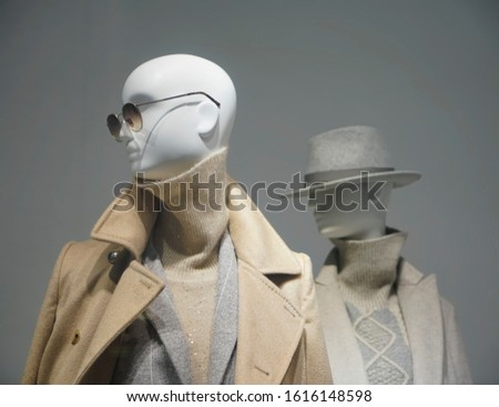 Two female mannequins wear luxury style winter clothes. Female mannequins in shop window. Standing women dummies show casual style collection of clothes in showcase Photo stock ©