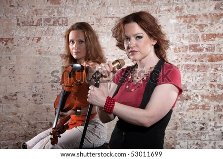 Two female musicians with violin and vocals