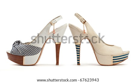 Two female open-toe shoes on the white background