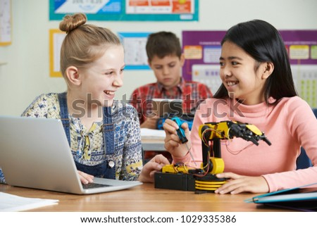 Two Female Pupils In Science Lesson Studying Robotics #1029335386