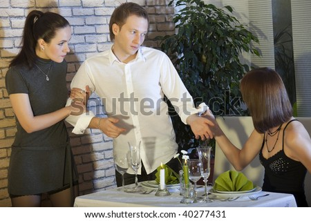 two female rivals fighting over man in a restaurant