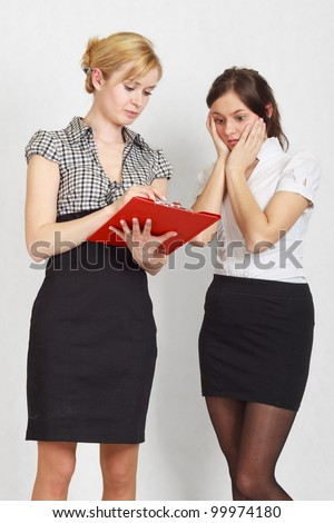 Two female students. One student is explaining something to another.