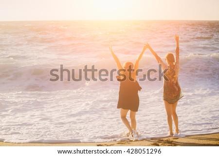 Shutterstock Two female traveler having fun at the beach