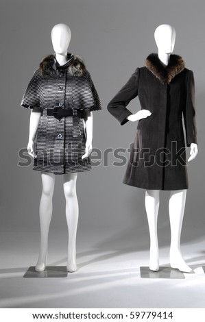 Two female winter coat on a light background