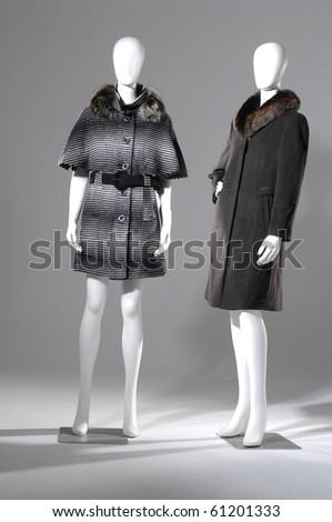 Two female winter fur coat on light background