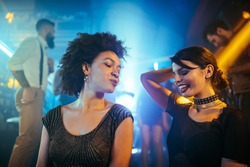 Two females enjoying a night out at a club