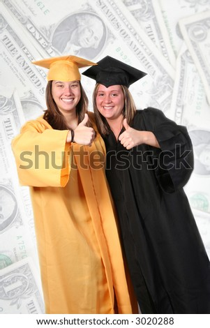 Two females in graduation gowns excited with their thumbs up