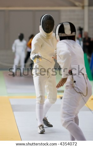 Two fencers practicing their sport