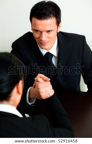 Two finance competitive worker while armwrestling