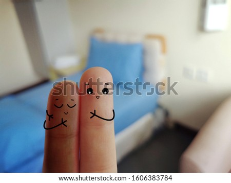 Two fingers decorated as two person. One person just recovered from sickness. His friend came to hospital to visit him.