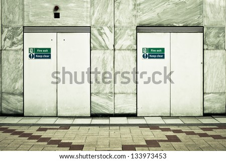 Two fire exit doors in a modern urban building