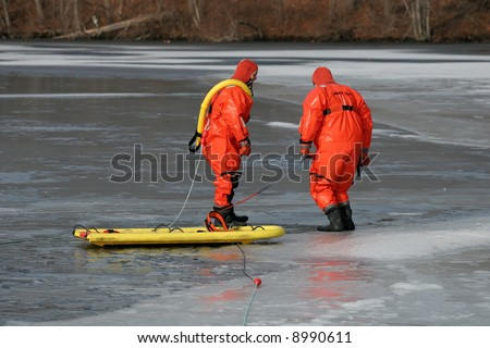 two firemen walking on ice preparing to practice saving technique