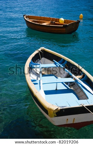 Two fishing boats floating on the water - stock photo