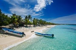 two fishing boats in Catalina island beach, a desert island near Punta Cana , Dominican Republic