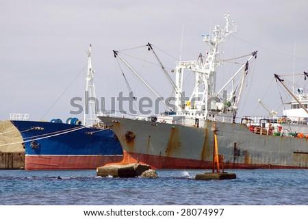 Two fishing ships beside quay. #28074997