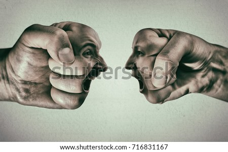 Two fists with a male and female face collide with each other on light background. Concept of confrontation, competition, family quarrel etc.